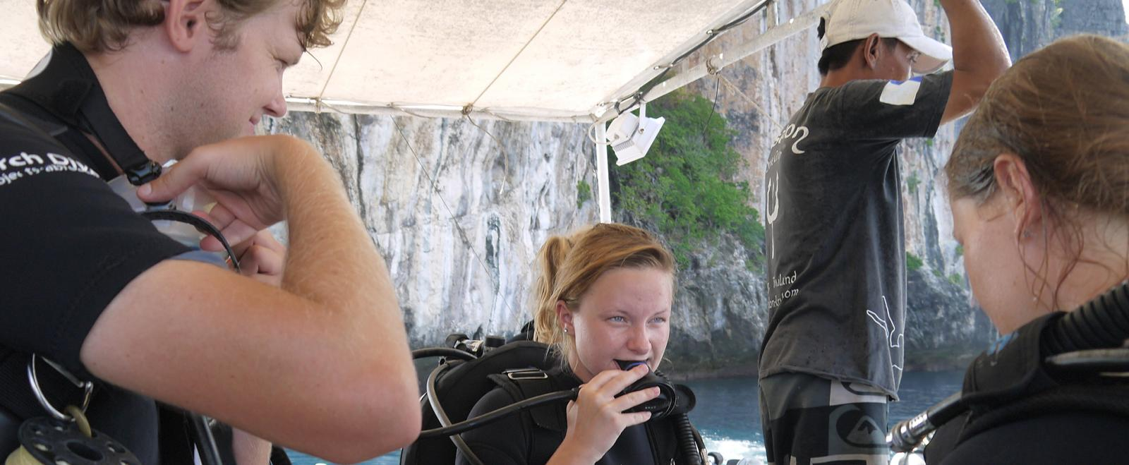 Conservation volunteers getting ready for a scuba dive in Thailand, Asia